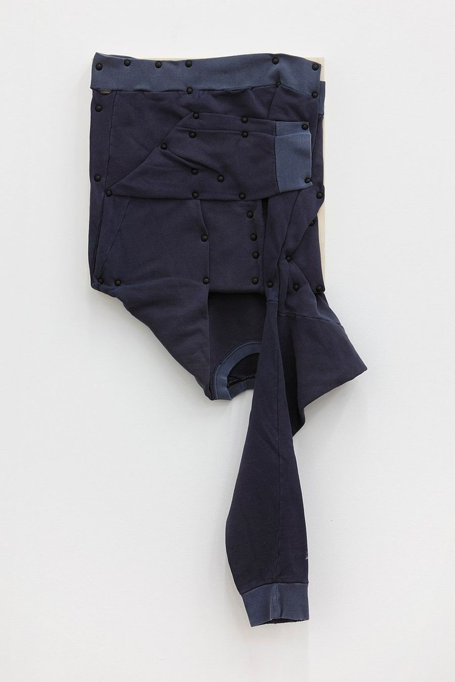 Tom Burr, his personal effects (long sleeve, blue), 2012. Men's sweatshirt, upholstery tacks and plywood, 37 x 15 in (94 x 38.1 cm).