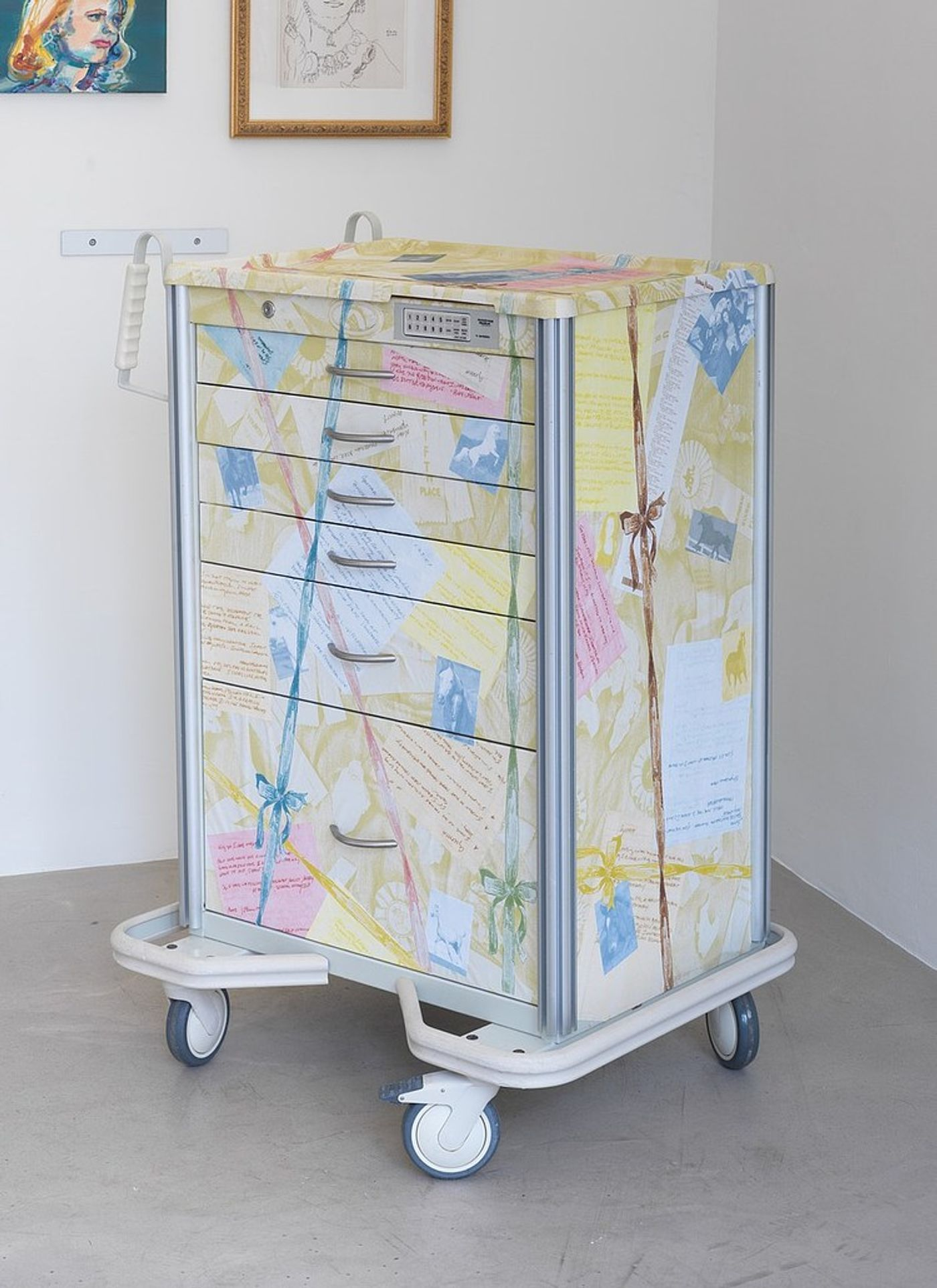 Cynthia Talmadge, Decoupaged Med Cart, 2021. Mod-Podge, notes taken by now-deceased therapist, collected horse clippings, original photographs of Eleanor Rines, medication cart, 44 x 27 x 19 in (111.8 x 68.6 x 48.3 cm).
