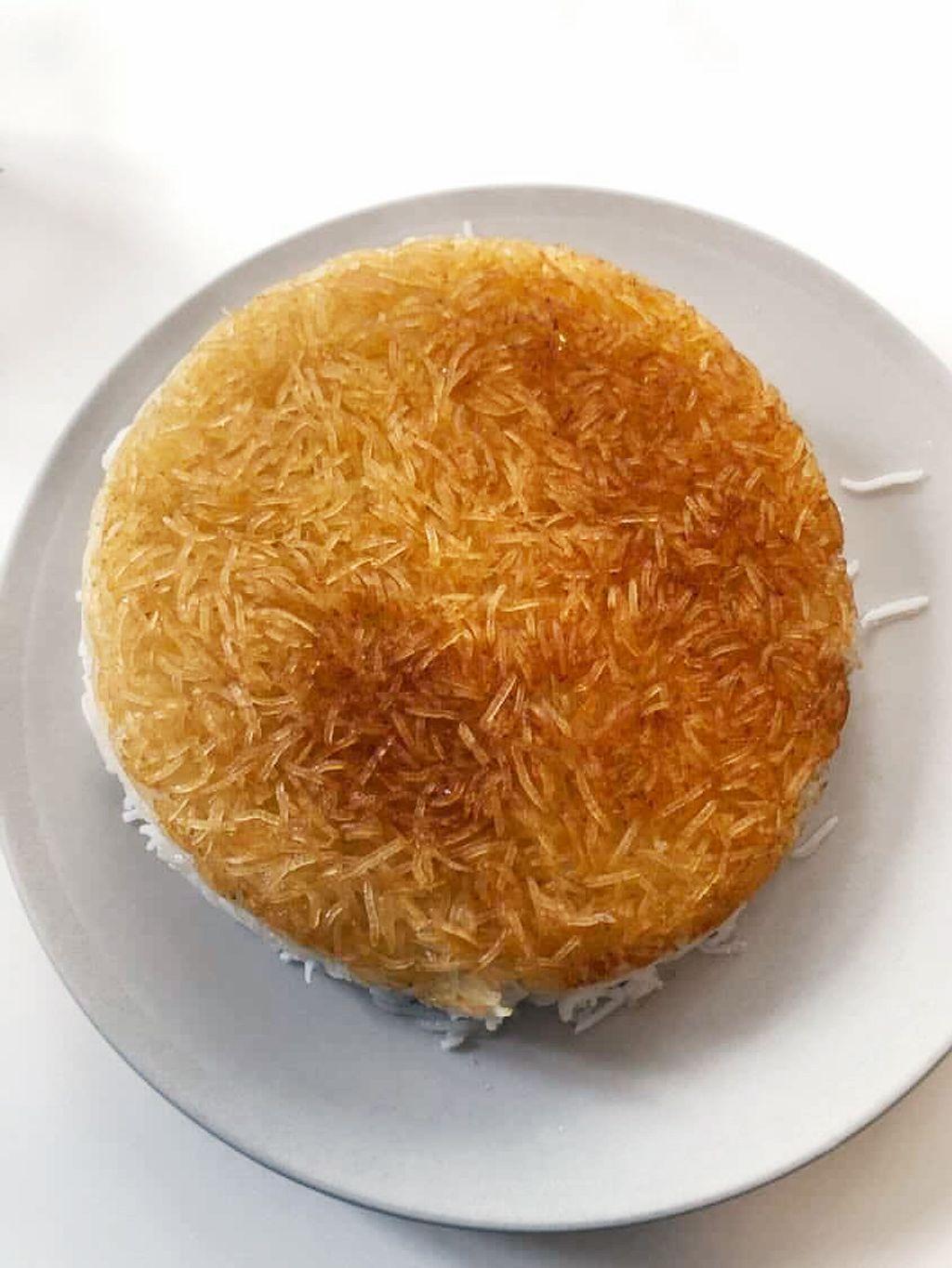 Tahdig betyr «bunnen av gryta», og er en persisk risrett med sprø skorpe.