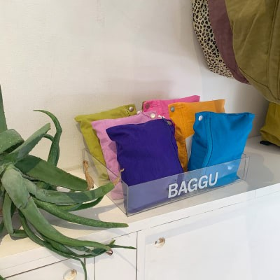 A group on colorful pouches on a white countertop