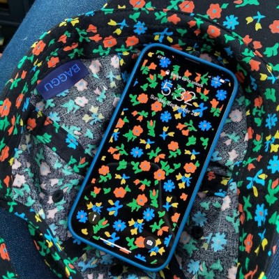 black calico floral baseball cap and iphone with calico floral wallpaper