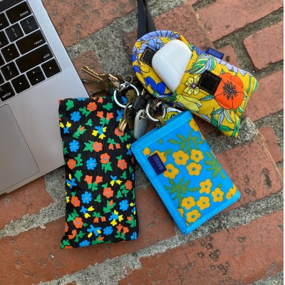 group image of the puffy earbuds case, nylon wallet, and lanyard pouch set in calico florals
