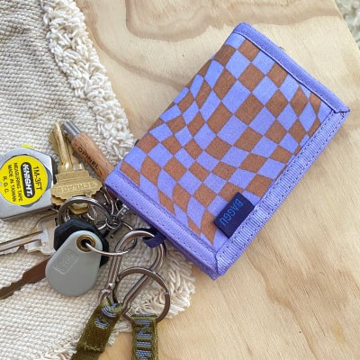 a lavender trippy checker wallet on a keyring