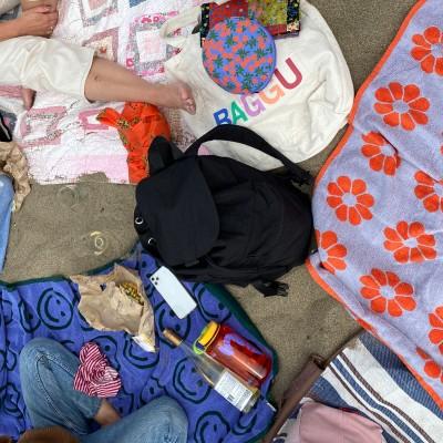 image of various baggu items and baggu friends at the beach :)