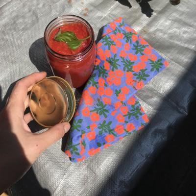 calico floral reusable cloth with a jar of pasta sauce