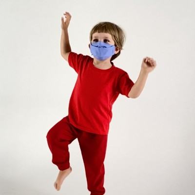 a child in a red shirt and red pants wearing the surf kids mask