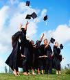 Graduates throwing hats in the air