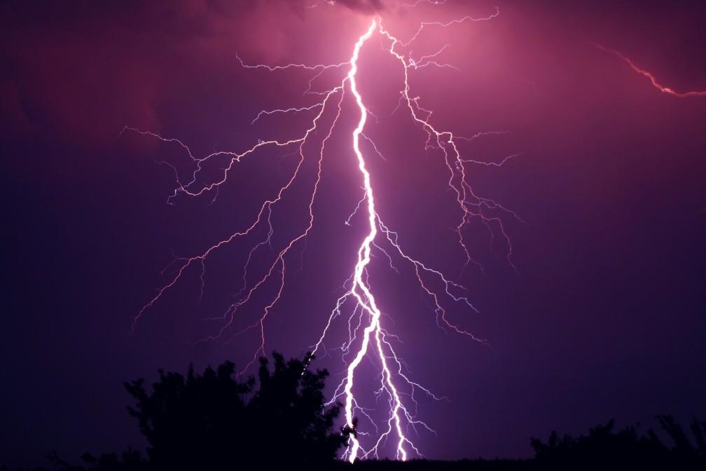 Lightning bolt striking ground at night