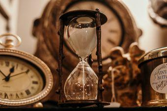 hourglass among maps and ancient clocks