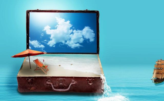 Suitcase open on beach with sky like a laptop setting