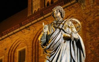 Statue of scientist holding an astrolabe