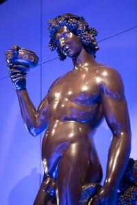 Statue of Bacchus holding grapes