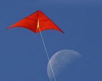 kite in blue sky with moon