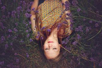 Girl smiling in a field of purple flowers