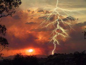 lightning hitting desert floor in sunset
