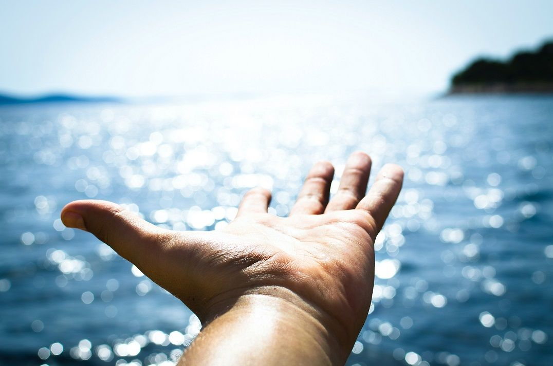 Open hand at the sea