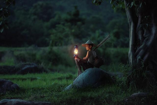 Boy in night with lantern