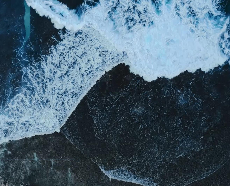 Waves on dark sand beach