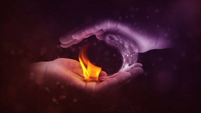 Hands surrounding a flame