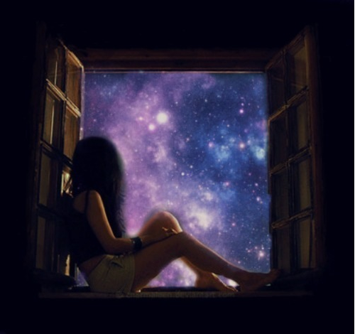 Girl in window looking out at universe at night with stars