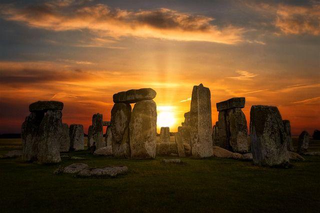 Stonehenge with sun shining through sunset
