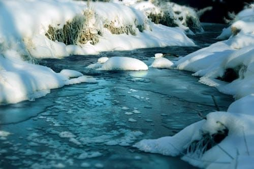 Icy stream with snow