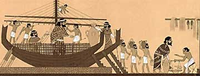 Ancient ship with slaves trading goods