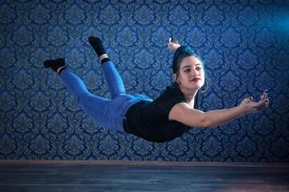 girl flying in room