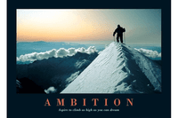 Climber on top of snowy mountain with words ambition