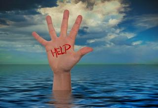 Hand coming out of water with help written on it