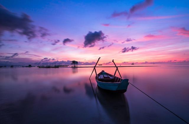 Colorful sunrise with boat