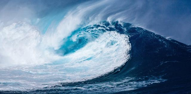 Waves crashing into sea