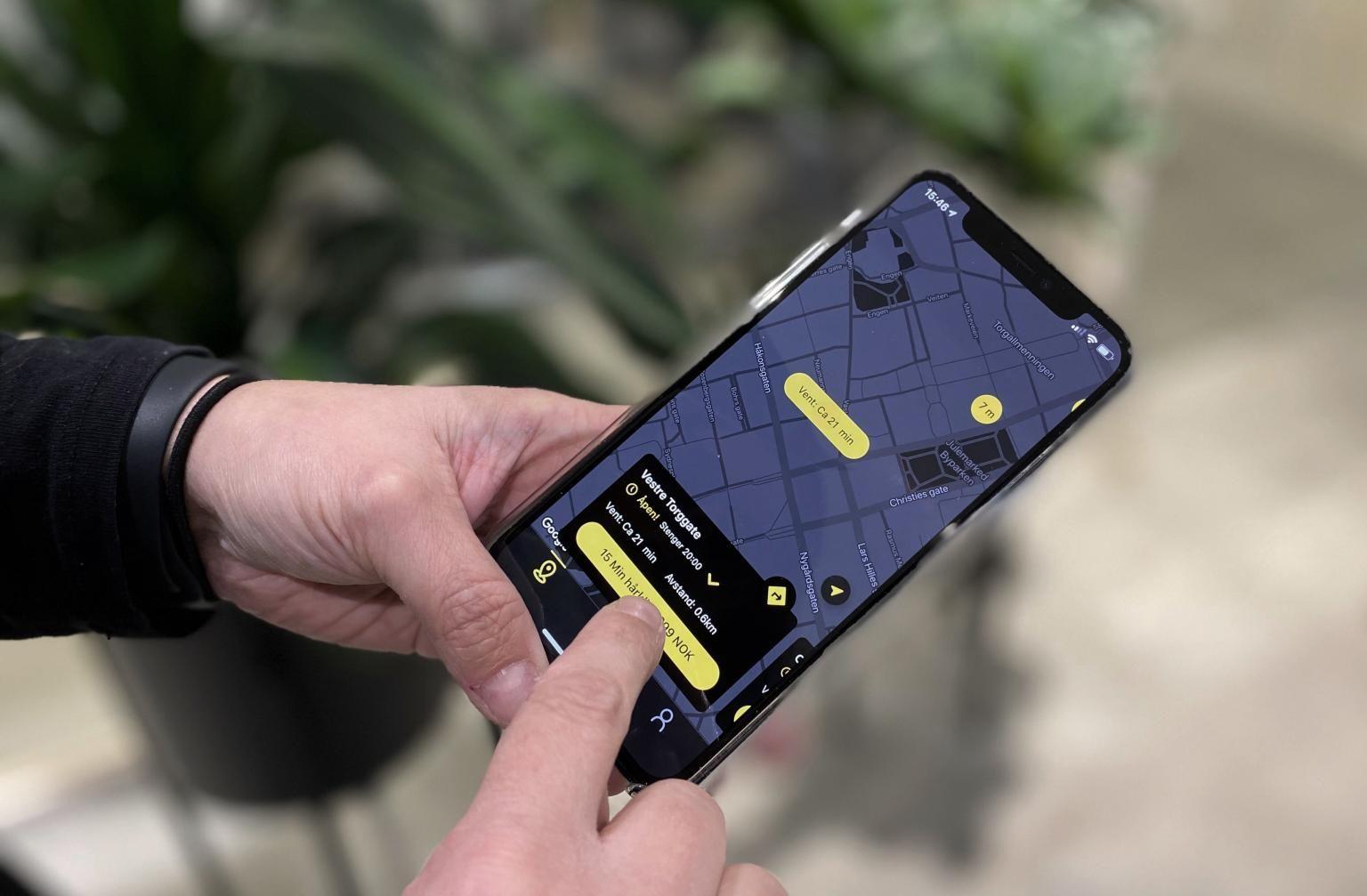 Mobil som viser Cutters appen