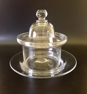 An Anglo-Irish plain glass butter dish, cover and stand made during the period 1790-1810