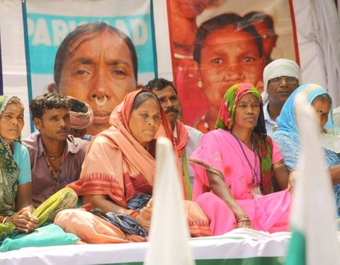 Image of Dalit people sitting on the ground