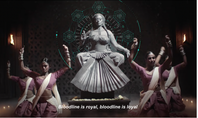 Image of a stone goddess with dancers around - screenshot from Bindis and Bangles video