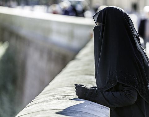 Image of a woman in a black niqab.