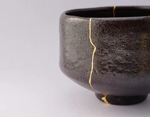 Image of a cracked pot, attached back together with gold