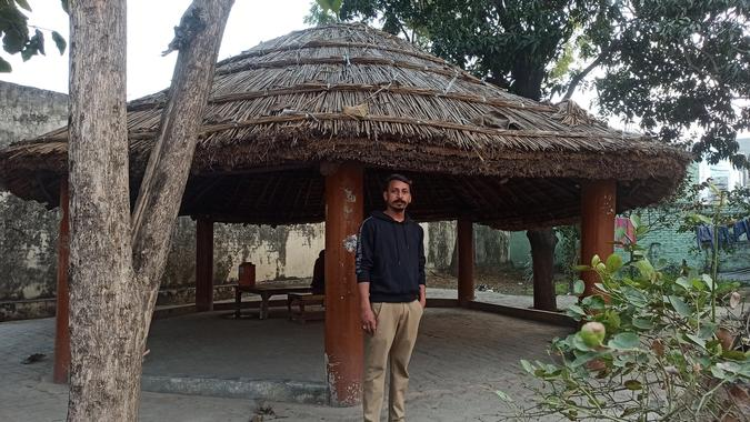 Bhagat Singh poses next to the thatched roof area where Bhim Army was born