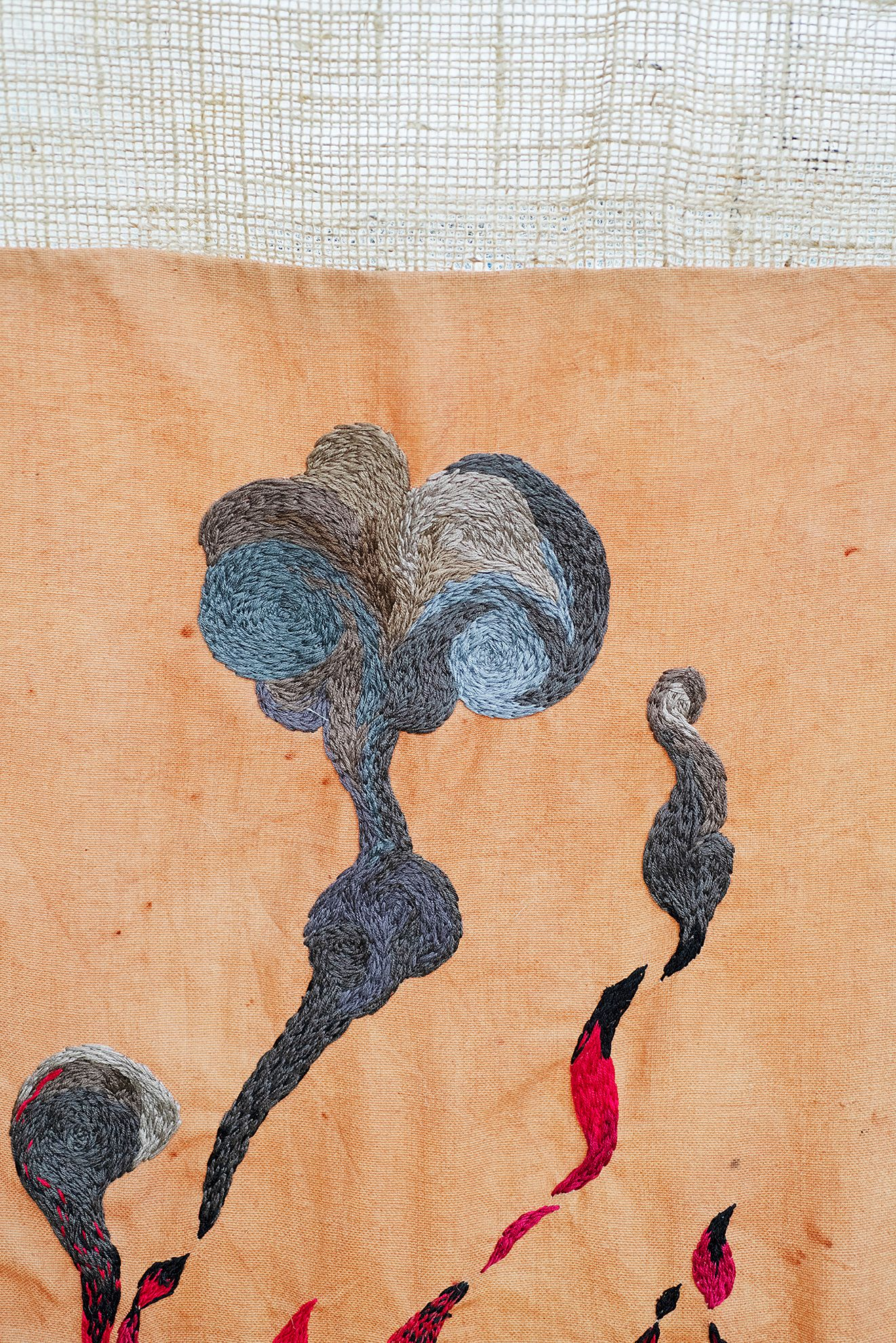 Quishile Charan, Burning Ganna Khet, 2021, cotton, embroidery thread, hessian sacks, natural dye: avocados, 153cm by 152cm. Close up of embroidery. Image taken by:Raymond Sagapolutele.