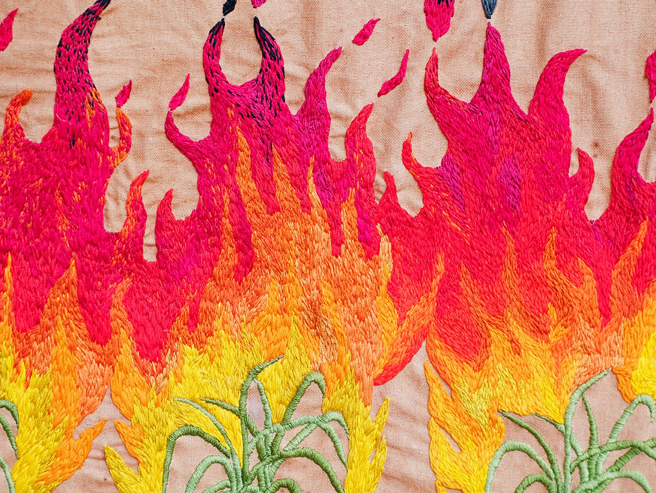 Quishile Charan, Burning Ganna Khet (Burning Sugarcane Farm), 2021, 153cm by 152cm, close up of embroidery detail. Technique: hand dyed textile, embroidery thread, cotton, hessian sacks. Textile is naturally dyed with avocado seeds. Image taken by: Raymond Sagapolutele.
