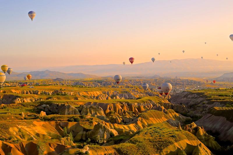 Balloons over landscape
