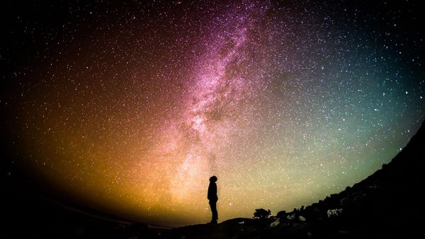 A person looking at the milky way galaxy
