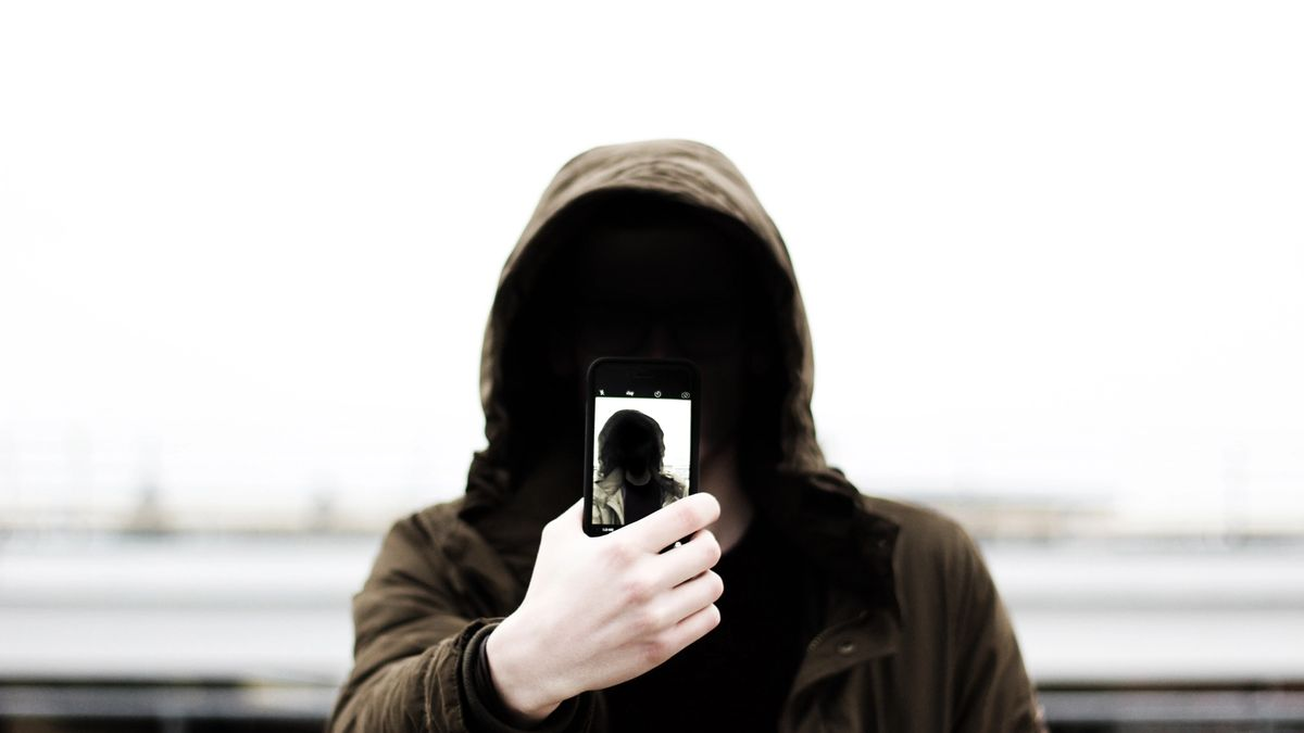 A person taking a photo of themselves taking a photo of themselves