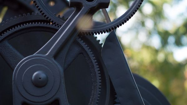 Old cogs on a machine, alluding to state machines being old and and machines.