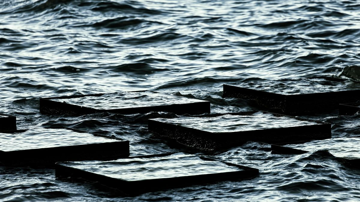 Blocks half-submerged in a busy sea