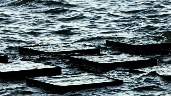 Blocks half-submerged in a busy sea