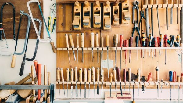 A bunch of tools mounted on the wall