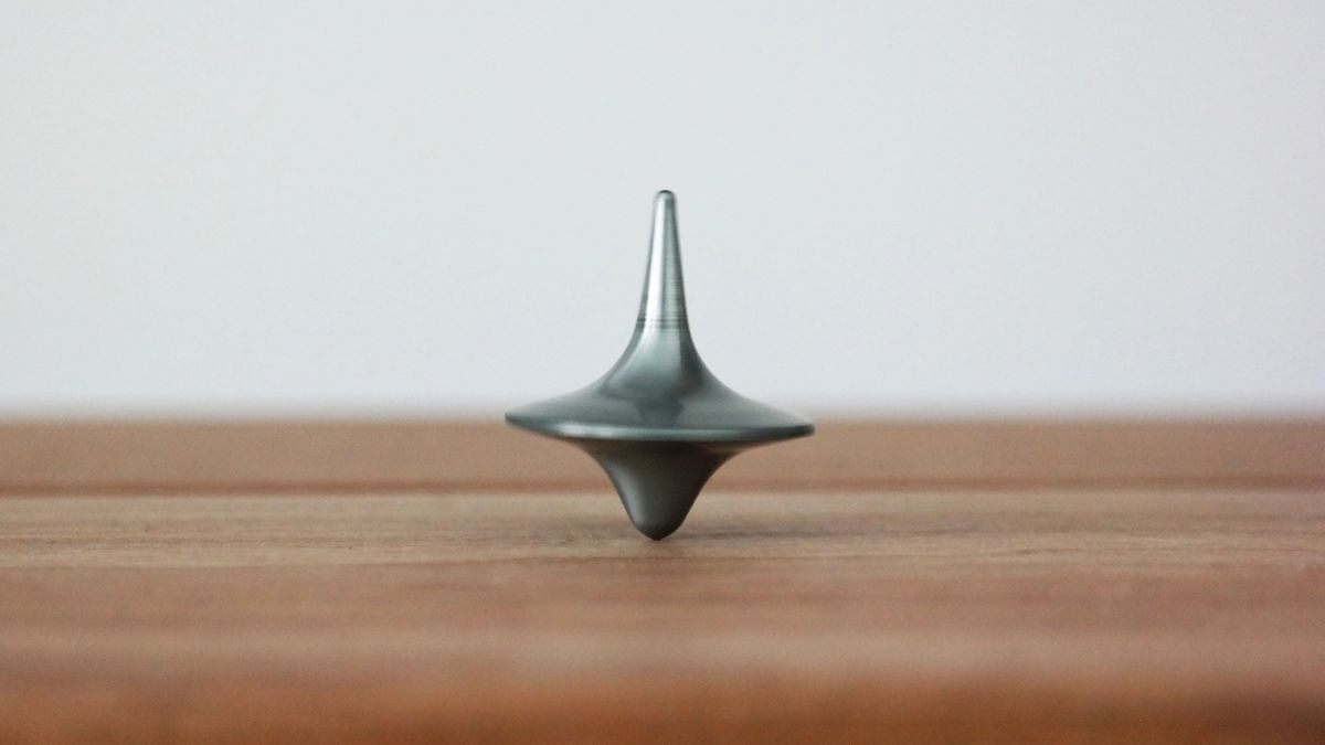 A dreidel spinning on a table