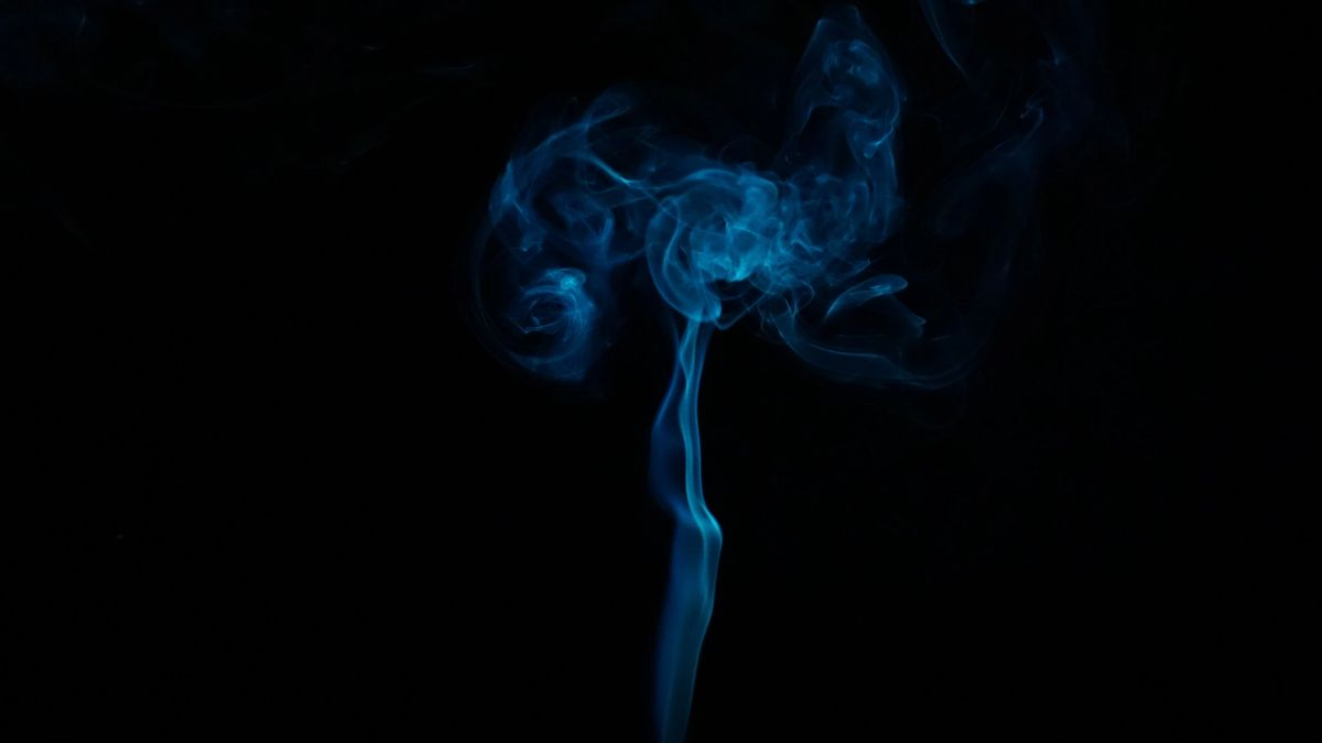 A cloud of blue smoke on black background